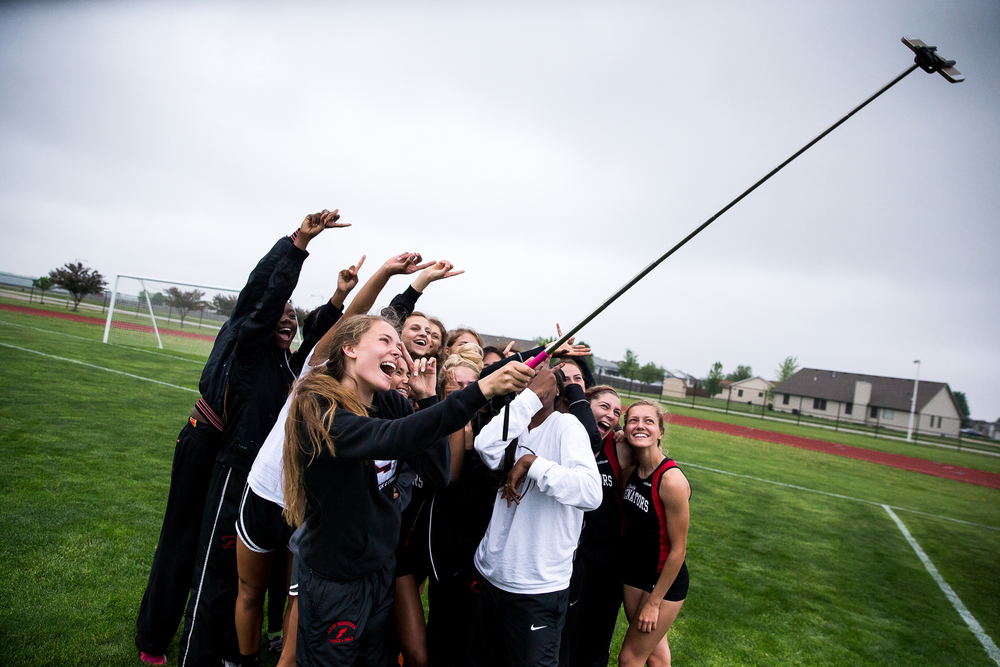 Springfield's Reilly Stiver uses a selfie stick to shoot a team photo after the Senators won the Girls Central State Eight Conference Track Meet at Glenwood High School, Saturday, May 9, 2015, in Chatham, Ill. Justin L. Fowler/The State Journal-Register