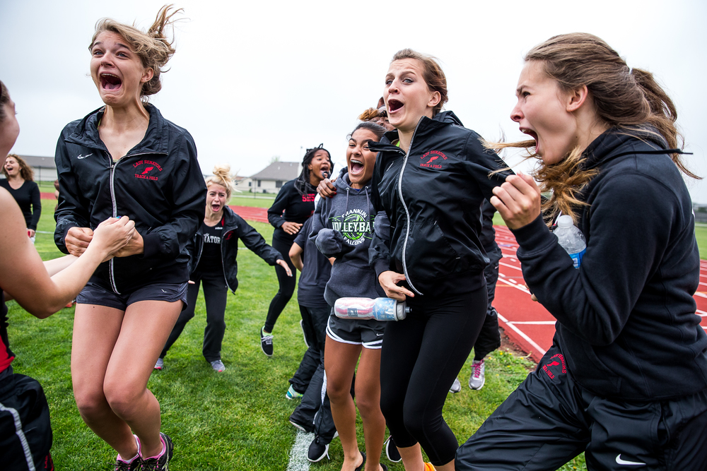 Springfield's Liz Canum, Jennifer Parsons and Reilly Stiver erupt as they hear the Senators won Girls Central State Eight Conference Track Meet at Glenwood High School, Saturday, May 9, 2015, in Chatham, Ill. Justin L. Fowler/The State Journal-Register