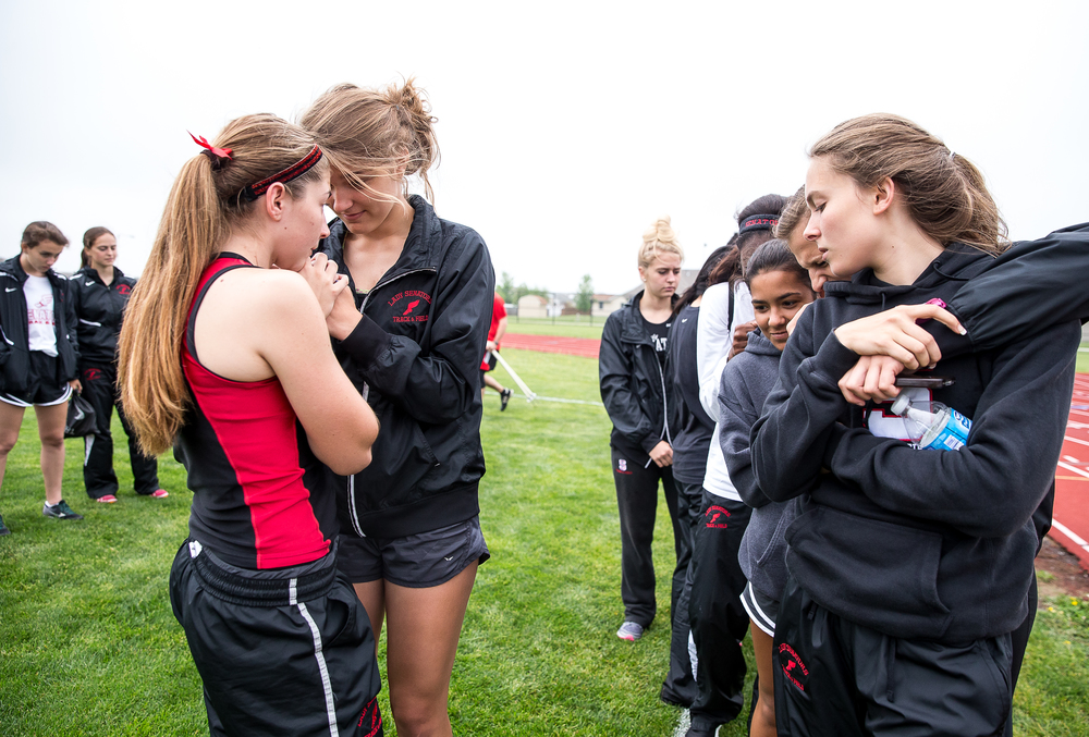 The Springfield girls track and field time wait as they listen as the final team rankings are called out during the Girls Central State Eight Conference Track Meet at Glenwood High School, Saturday, May 9, 2015, in Chatham, Ill. Justin L. Fowler/The State Journal-Register