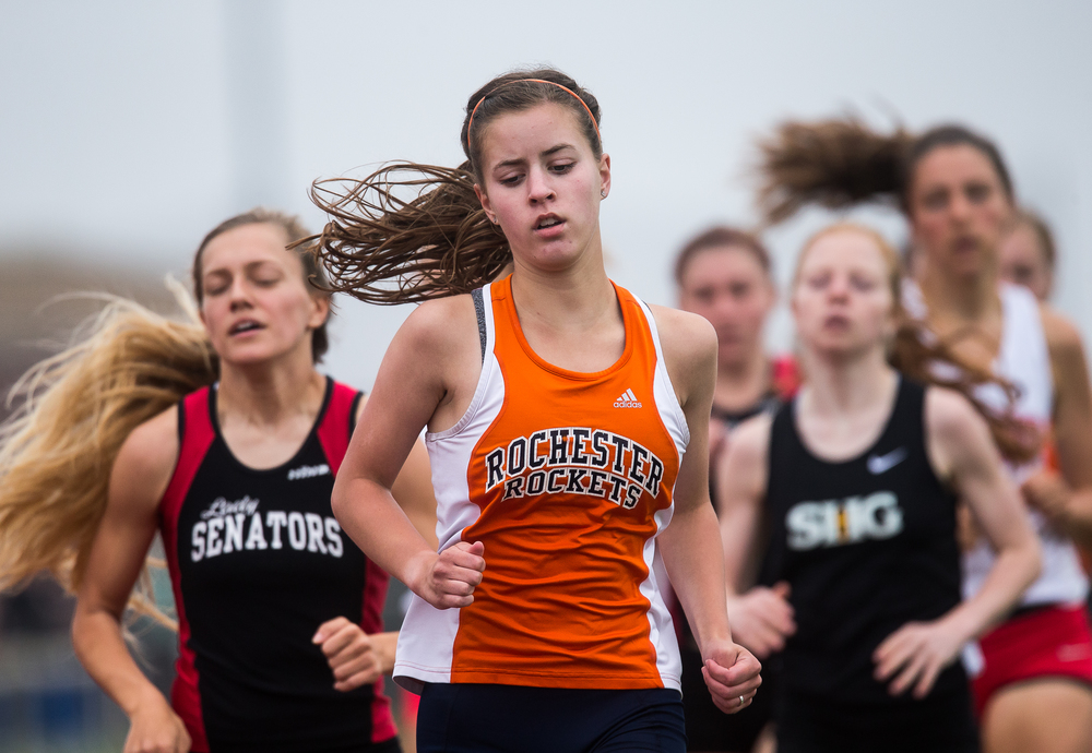 Rochester's Madeline Campbell leads the pack on the first lap of the 1600m Run during the Girls Central State Eight Conference Track Meet at Glenwood High School, Saturday, May 9, 2015, in Chatham, Ill. Campbell finished third with a time of 5:26.78. Justin L. Fowler/The State Journal-Register