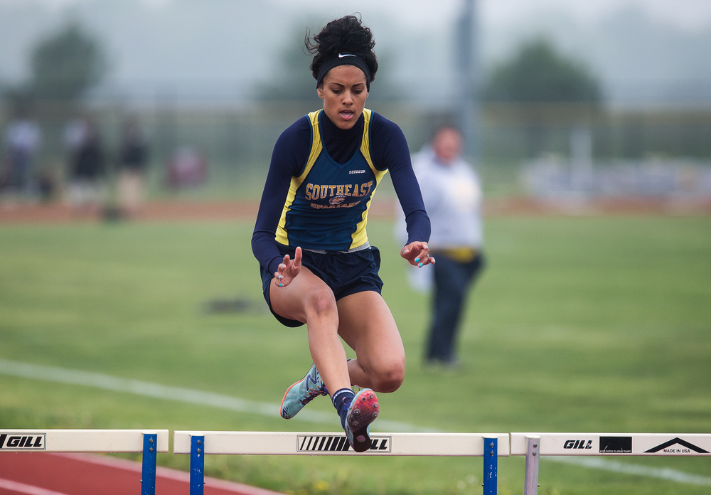 Southeast's Lunden Henry wins the 300m Hurdles with a time of 45.96 during the Girls Central State Eight Conference Track Meet at Glenwood High School, Saturday, May 9, 2015, in Chatham, Ill. Justin L. Fowler/The State Journal-Register