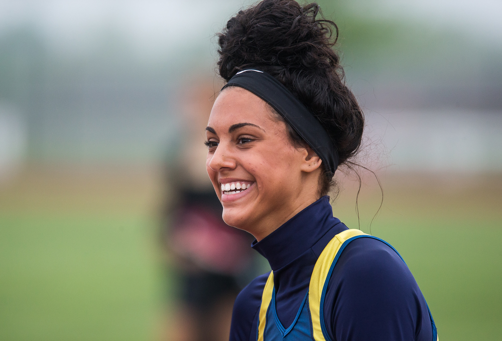 Southeast's Lunden Henry is all smiles after winning the 300m Hurdles with a time of 45.96 during the Girls Central State Eight Conference Track Meet at Glenwood High School, Saturday, May 9, 2015, in Chatham, Ill. Justin L. Fowler/The State Journal-Register