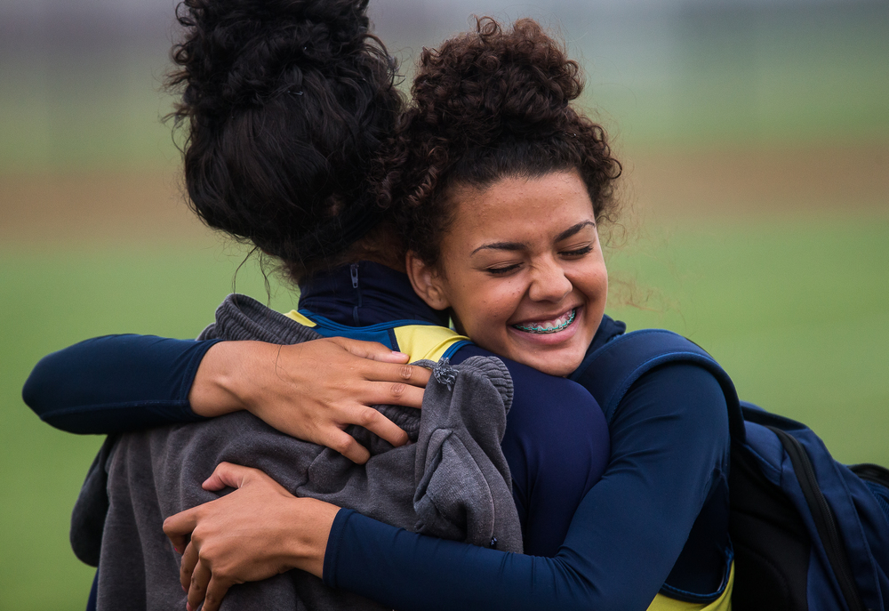 Southeast's Alexis Henry hugs her sister Lunden Henry after she won the 300m Hurdles with a time of 45.96 during the Girls Central State Eight Conference Track Meet at Glenwood High School, Saturday, May 9, 2015, in Chatham, Ill. Justin L. Fowler/The State Journal-Register