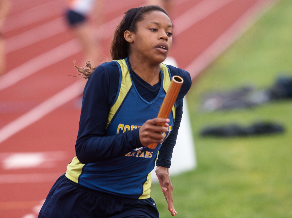 Southeast's Charlicia Watson runs the second leg of the 4x400m Relay during the Girls Central State Eight Conference Track Meet at Glenwood High School, Saturday, May 9, 2015, in Chatham, Ill. Justin L. Fowler/The State Journal-Register