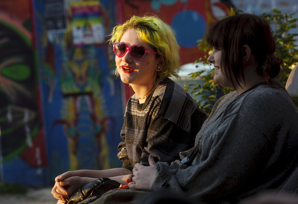 Daphne Lyon waits on a bench outside The Black Sheep before a concert Friday, May 1, 2015. Ted Schurter/The State Journal-Register