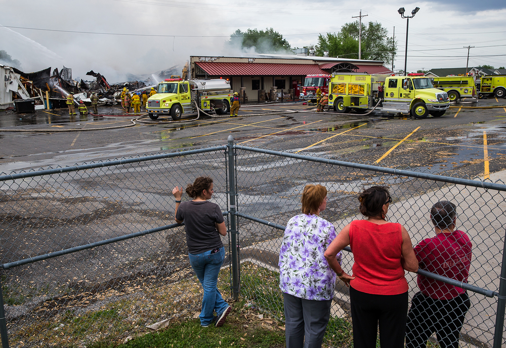 People watch fire fighters battle a blaze that destroyed the County Market grocery store, Thursday, May 7, 2015, in Girard, Ill. Justin L. Fowler/The State Journal-Register