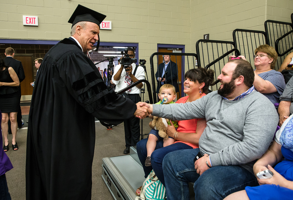 Gov. Bruce Rauner shakes hands with Jantz Spalding, of Galesburg, Ill., prior to delivering his commencement address during the 148th annual Commencement for Lincoln College at Jack D. Nutt Arena, Saturday, May 9, 2015, in Lincoln, Ill. Justin L. Fowler/The State Journal-Register
