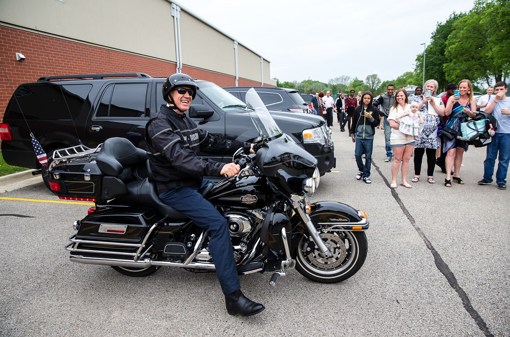Gov. Bruce Rauner heads out on his Harley-Davidson motorcycle after delivering the commencement address during the 148th annual Commencement for Lincoln College at Jack D. Nutt Arena, Saturday, May 9, 2015, in Lincoln, Ill. Justin L. Fowler/The State Journal-Register