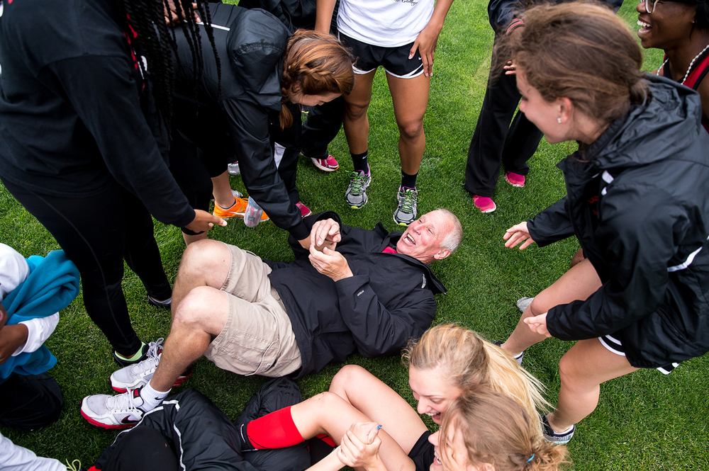 Springfield High School girls track coach Eric Warren hits the grass after being tackled by his team after the Senators won the Girls Central State Eight Conference Track Meet at Glenwood High School, Saturday, May 9, 2015, in Chatham, Ill. Justin L. Fowler/The State Journal-Register
