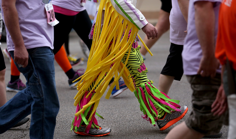 A participant walking in the 8th annual Fat Ass 5K made a statement with the personal style of his legware Saturday, May 9, 2015. The race and street party downtown raises money for charity. David Spencer/The State Journal-Register