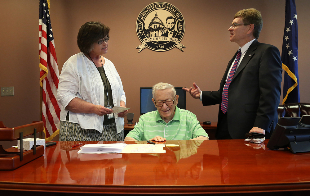 Springfield Mayor Jim Langfelder spent part of his first official day in office showing his father, and former mayor, Ossie, his office at Municipal Center West Friday May 8, 2015. Norma Trepal, left, is division manager in the Office of Corporation Counsel for the City of Springfield. David Spencer/The State Journal-Register