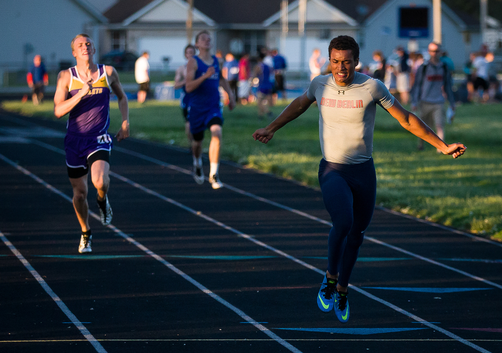 New Berlin's Kahlil Wassell leans into the finish line to win the Boys 400mm Run during the Sangamon County Track and Field Meet at Riverton Middle School, Monday, May 11, 2015, in Riverton, Ill. Justin L. Fowler/The State Journal-Register