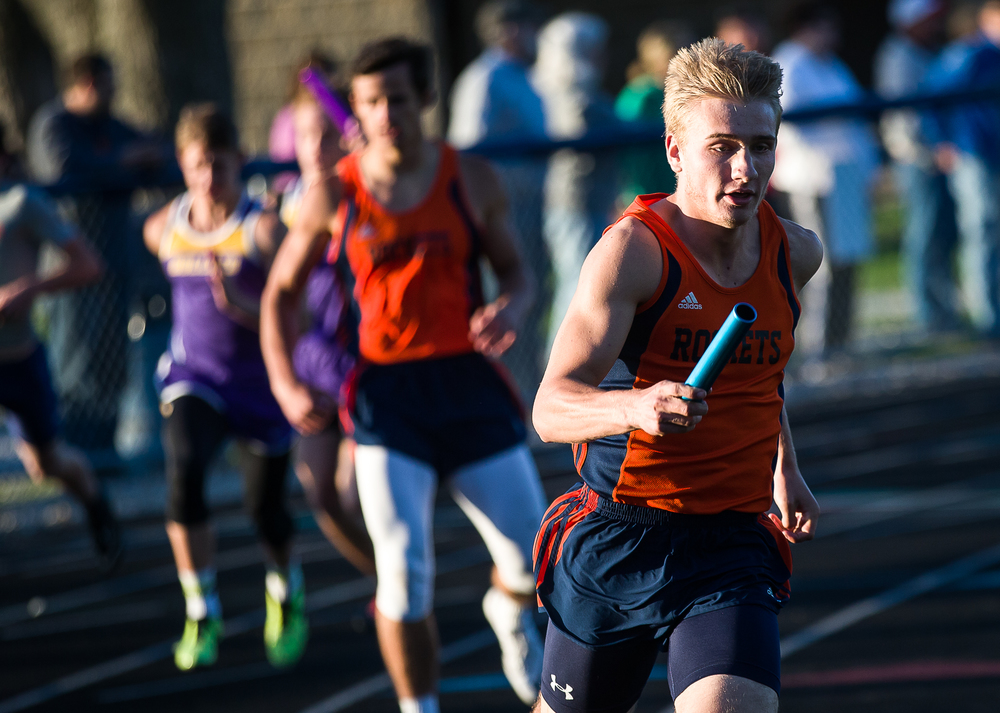 Rochester's Alex Ulbrich takes the baton from Jeremy Bivens to run the third leg of the Boys 4x200m Relay during the Sangamon County Track and Field Meet at Riverton Middle School, Monday, May 11, 2015, in Riverton, Ill. Justin L. Fowler/The State Journal-Register