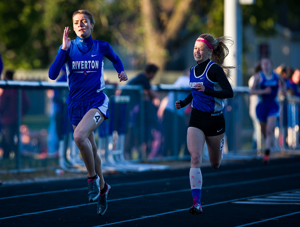 Riverton's Lexi Yoggerst takes the lead against Auburn's Rebecca Downs as she goes on to win the Girls 400m Run during the Sangamon County Track and Field Meet at Riverton Middle School, Monday, May 11, 2015, in Riverton, Ill. Justin L. Fowler/The State Journal-Register