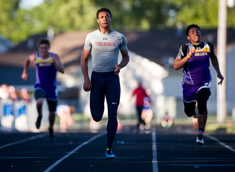 New Berlin's Kahlil Wassell takes the lead in the Boys 100m Dash during the Sangamon County Track and Field Meet at Riverton Middle School, Monday, May 11, 2015, in Riverton, Ill. Justin L. Fowler/The State Journal-Register