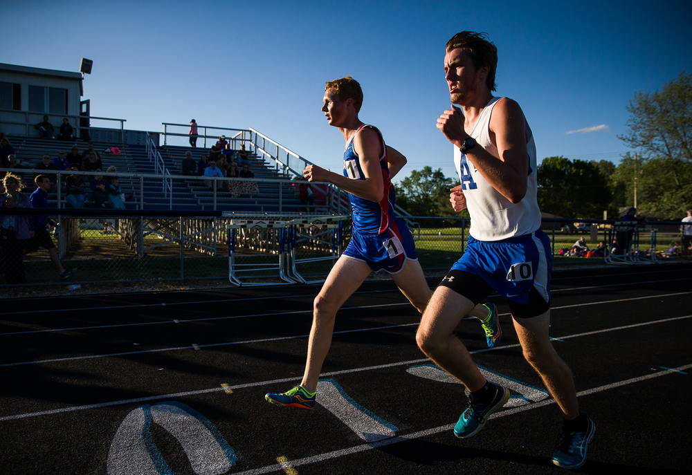 Pleasant Plains's Tyler Johnson passes a lapped runner on the outside on his way to winning the Boys 3200m Run during the Sangamon County Track and Field Meet at Riverton Middle School, Monday, May 11, 2015, in Riverton, Ill. Justin L. Fowler/The State Journal-Register