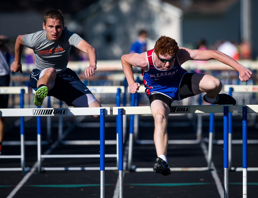 Pleasant Plains' Jake Wayda edges out New Berlin's Evan Gustafson to win the Boys 110m Hurdles during the Sangamon County Track and Field Meet at Riverton Middle School, Monday, May 11, 2015, in Riverton, Ill. Justin L. Fowler/The State Journal-Register