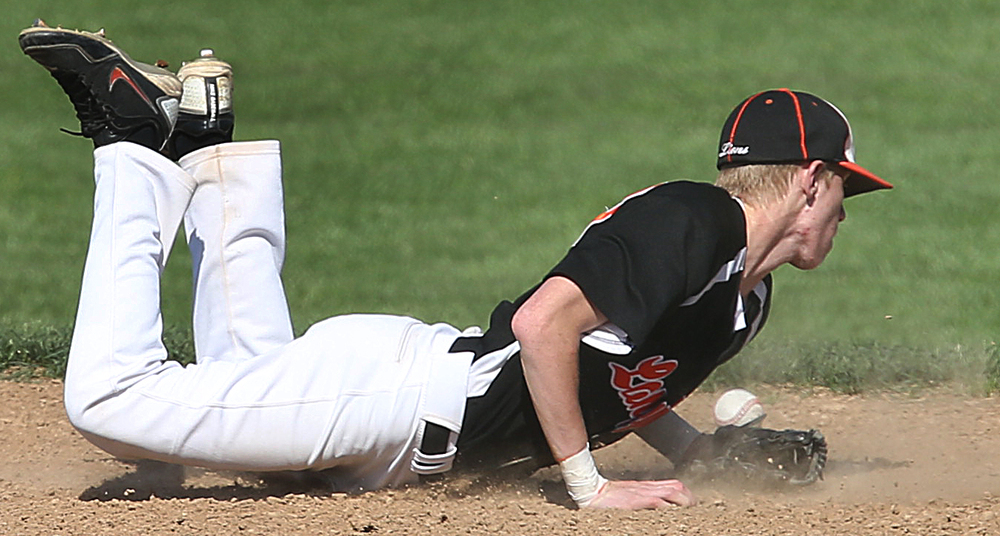 Lanphier second baseman Jake McLean can't get his glove on a hard infield hit by SHG batter Cole Daily in the first inning. The Sacred Heart Griffin Cyclones defeated the Lanphier High School Lions 15-5 to win the championship of the City Series Baseball Tournament at Robin Roberts Stadium in Springfield on Tuesday, May 12, 2015. David Spencer/The State Journal-Register