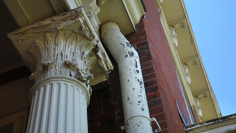 Porch columns like this one at the mansion are crumbling with paint peeling, as seen during a tour on Tuesday, May 12, 2015. David Spencer/The State Journal-Register