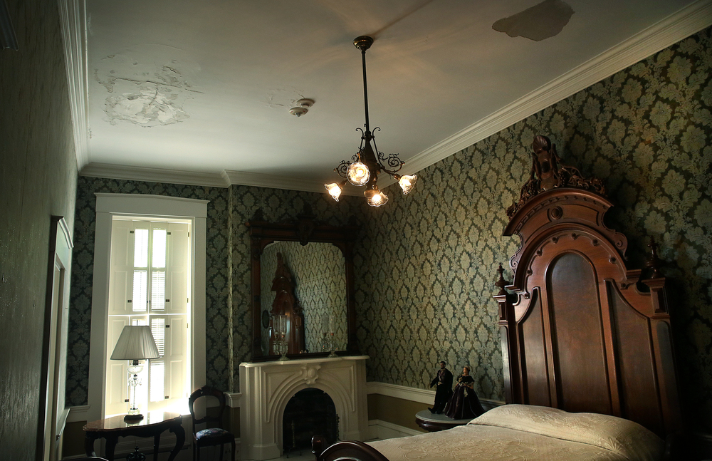 Part of the plaster and paint on the ceiling of the Lincoln Bedroom in the mansion has been compromised due to water intrusion from a leaky roof seen during a tour on Tuesday, May 12, 2015. David Spencer/The State Journal-Register