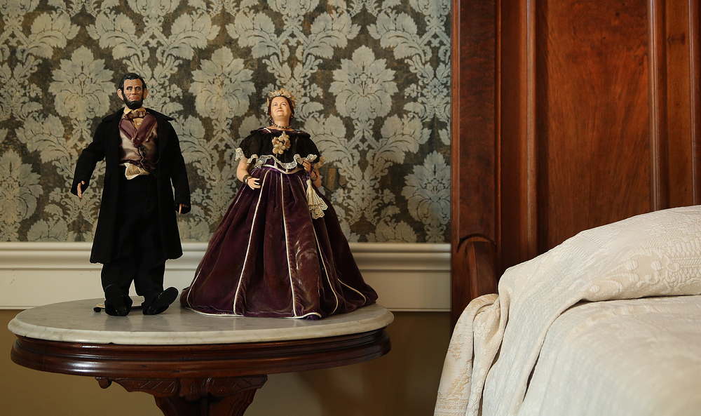 Dolls of Mary Todd and President Abraham Lincoln occupy a table next to the bed inside the Lincoln Bedroom at the mansion seen during a tour on Tuesday, May 12, 2015.  David Spencer/The State Journal-Register