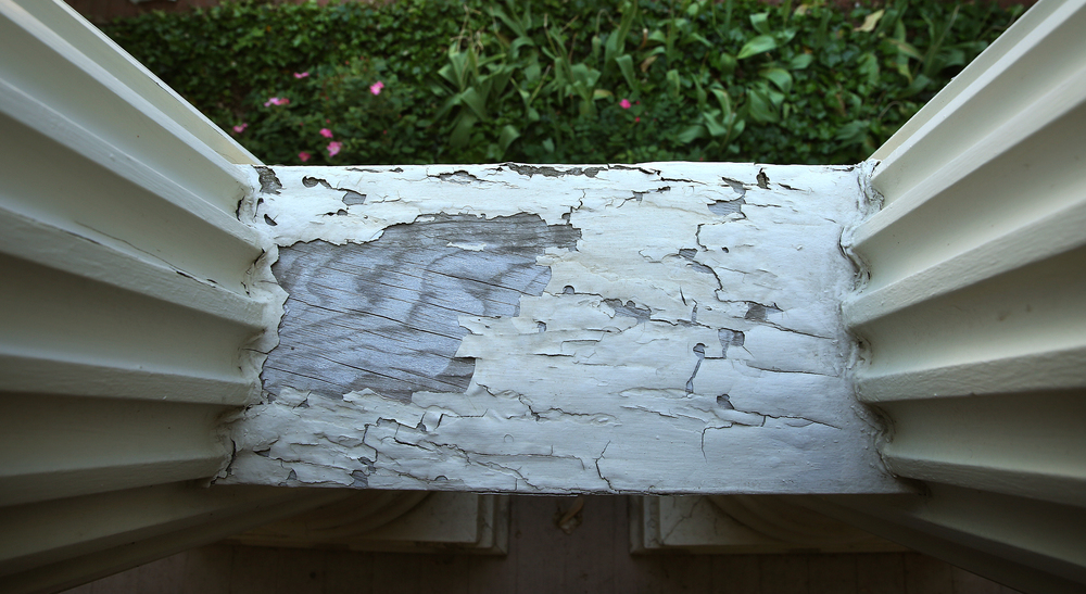 Peeling paint, down to the bare wood in many cases as seen on this wood rail topping a balustrade on the East porch, is seemingly everywhere on the exterior of the mansion, seen during a tour on Tuesday, May 12, 2015. David Spencer/The State Journal-Register