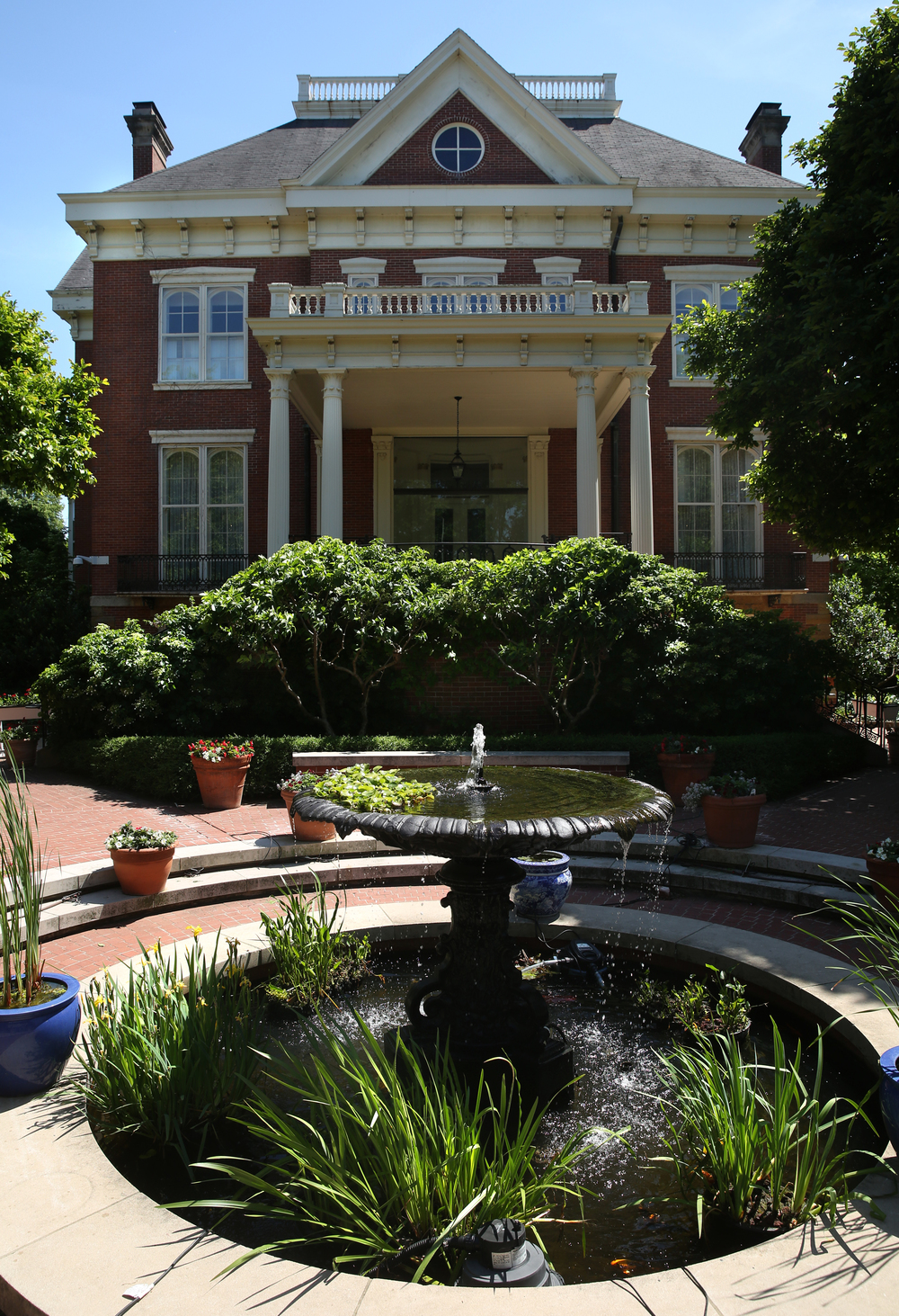 Despite a backdrop of needed repairs, Mansion horticulturalist Harry Lewis has done an extensive beautification of the grounds and gardens of the Executive Mansion over the last several years, including water plants within this renovated fountain on the north front seen during a tour of the property on Tuesday, May 12, 2015. David Spencer/The State Journal-Register
