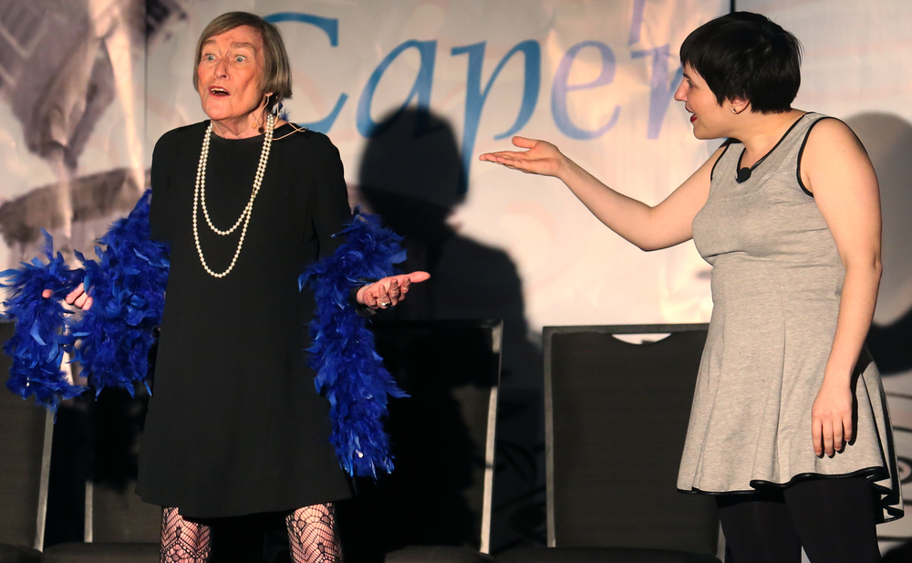 House Majority Leader Barbara Flynn Currie at left is introduced by Second City Company member Julie Marchiano onstage Wednesday night. David Spencer/The State Journal-Register