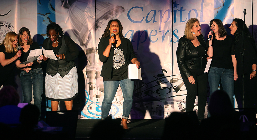 "Along with other legislators, Sen. Toi Hutchinson at center sings ""Can't Buy Me Love"" onstage Wednesday evening. David Spencer/The State Journal-Register"