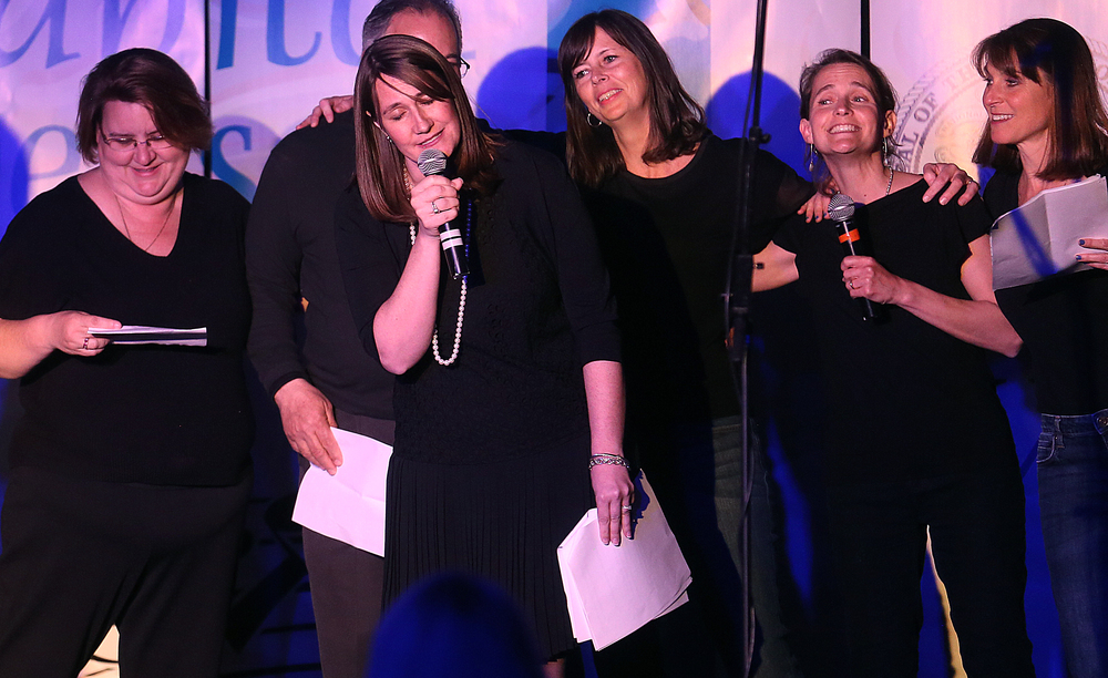 "COWL co-chair Rep. Emily McAsey sings along with other legislators during the musical number ""Session Nights"" onstage Wednesday evening. David Spencer/The State Journal-Register"