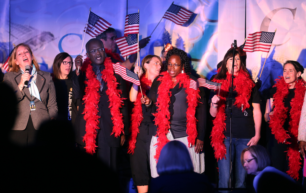 "Legislators concluded the show by waving American flags while singing ""God Bless America"" onstage Wednesday evening. David Spencer/The State Journal-Register"