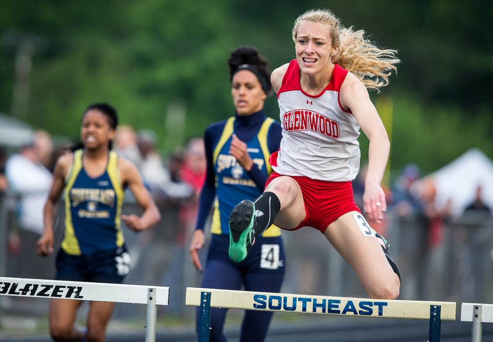 Glenwood's Alison Woerner clears a hurdle on her way to winning the Girls 300m Hurdles during the Girls Class 2A Sectional Track Meet at  Southeast High School, Thursday, May 14, 2015, in Springfield, Ill. Justin L. Fowler/The State Journal-Register