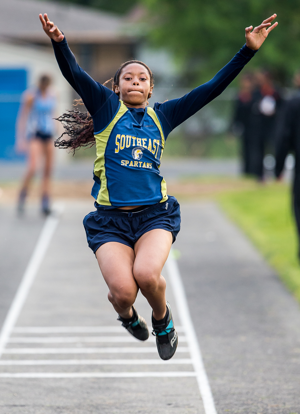 Southeast's Charlicia Watson competes in the Girls Triple Jump during the Girls Class 2A Sectional Track Meet at  Southeast High School, Thursday, May 14, 2015, in Springfield, Ill. Justin L. Fowler/The State Journal-Register