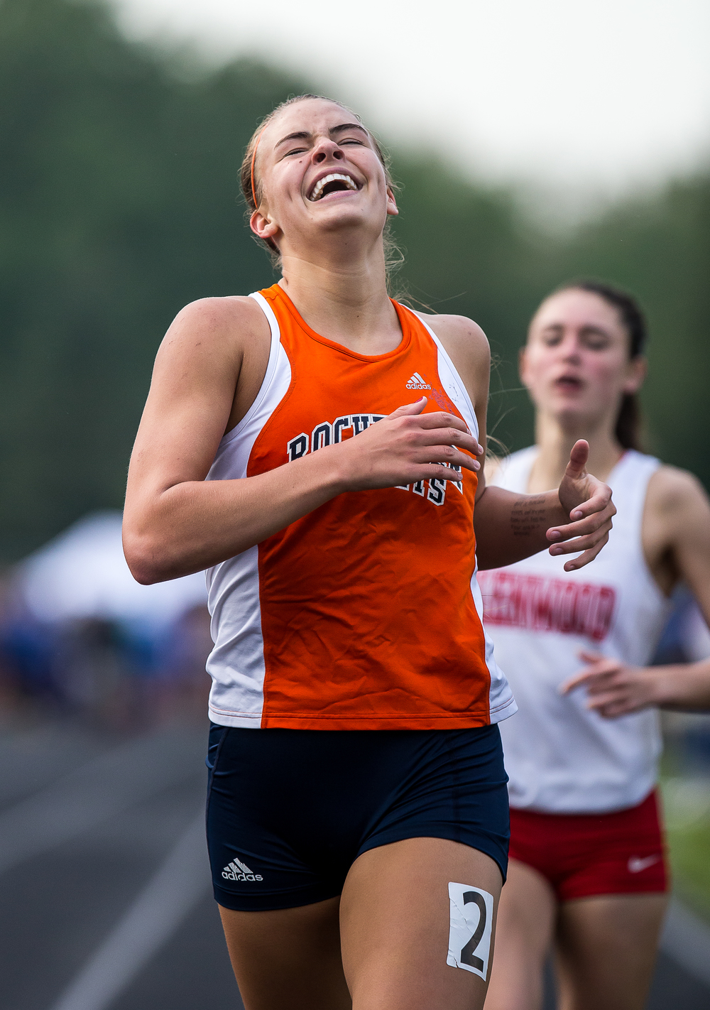 Rochester's Meagan McNicholas reacts after coming from behind to beat Glenwood's Erica Rideout in the Girls 800m Run during the Girls Class 2A Sectional Track Meet at  Southeast High School, Thursday, May 14, 2015, in Springfield, Ill. Justin L. Fowler/The State Journal-Register