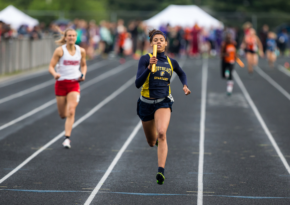 Southeast's Jamari Drake runs the final leg to bring home the victory in the Girls 4x200m Relay during the Girls Class 2A Sectional Track Meet at  Southeast High School, Thursday, May 14, 2015, in Springfield, Ill. Justin L. Fowler/The State Journal-Register
