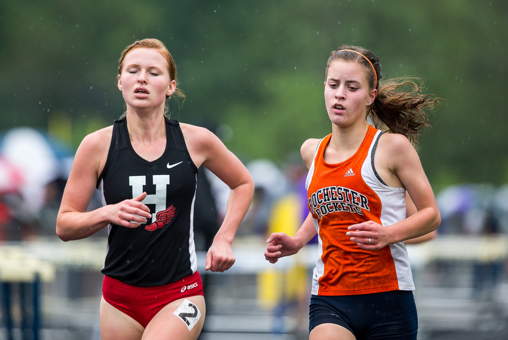 Rochester's Maddie Campbell battles with Highland's Jayden Shelton in the Girls 3200m Run during the Girls Class 2A Sectional Track Meet at  Southeast High School, Thursday, May 14, 2015, in Springfield, Ill. Justin L. Fowler/The State Journal-Register