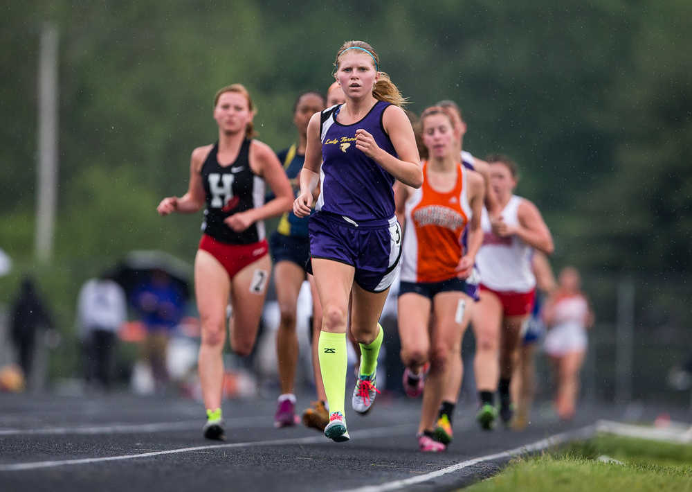 Taylorville's Anna Lowry leads the pack in the opening laps of the Girls 3200m Run during the Girls Class 2A Sectional Track Meet at  Southeast High School, Thursday, May 14, 2015, in Springfield, Ill. Lowry finished third in the race and qualified for state with a time of 11:35.11. Justin L. Fowler/The State Journal-Register