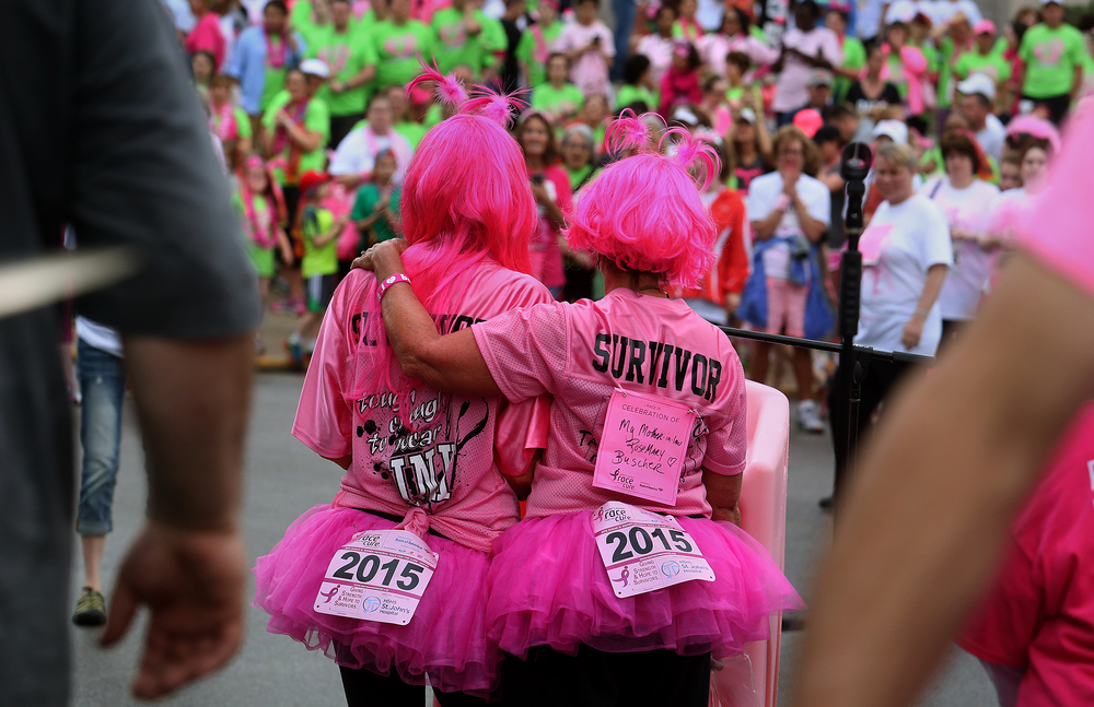 A team of five survivors who call themselves the Pinkalicious Bullets took part in the race. Sherman residents Jennie Creswell, left (6 year survivor) and Michelle Buscher (5 year survivor) stand together and introduce their team during the opening ceremony in which team representatives took part. David Spencer/The State Journal-Register