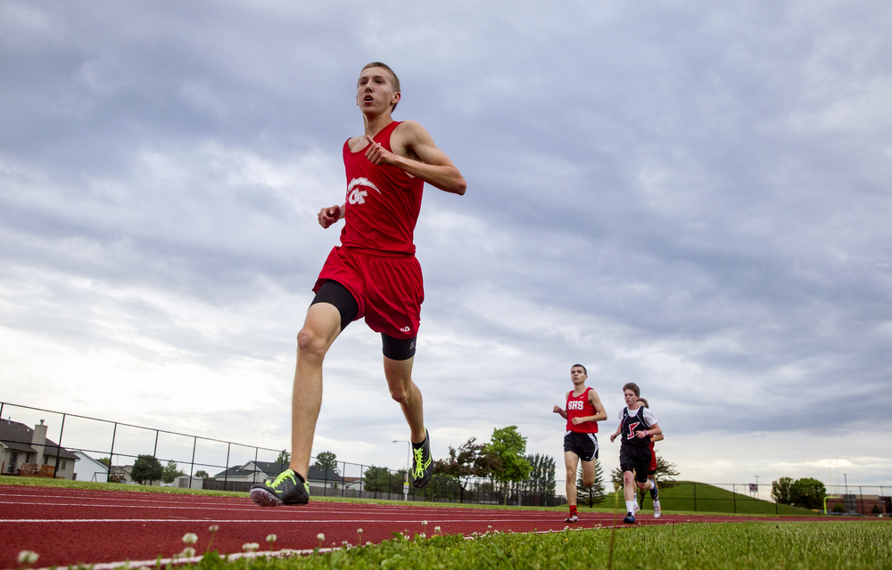 Glenwood's Landon Skelly opens up a lead in the final laps of the Boys 3200m Run during the Boys Central State Eight Track & Field Meet at Glenwood High School, Friday, May 15, 2015, in Chatham, Ill. Justin L. Fowler/The State Journal-Register