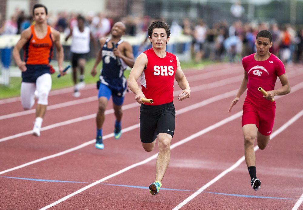 Springfield's Alex Deleon, center, sprints home for a Senator victory, with a broken finger, in the Boys 4x100m Relay with a time of 42.98 during the Boys Central State Eight Track & Field Meet at Glenwood High School, Friday, May 15, 2015, in Chatham, Ill. Justin L. Fowler/The State Journal-Register