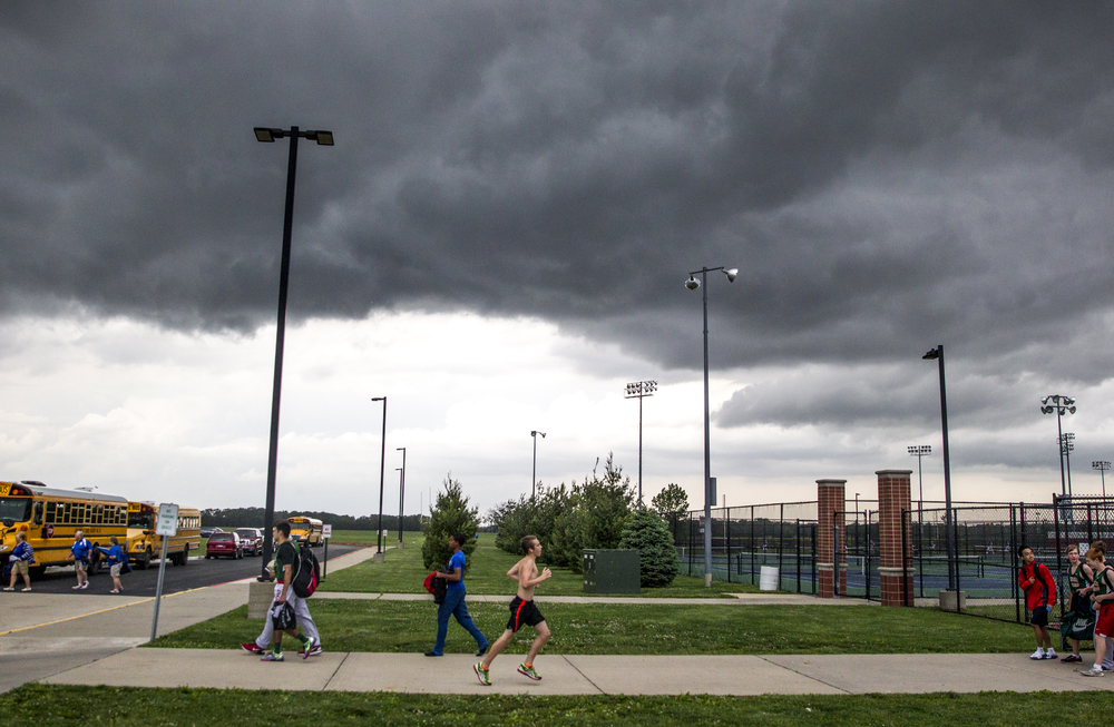 Athletes make their way into the gym of Glenwood High School for safety as a storm approaches delaying the start of the Boys Central State Eight Track & Field Meet, Friday, May 15, 2015, in Chatham, Ill. Justin L. Fowler/The State Journal-Register