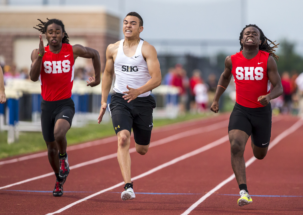 Sacred Heart-Griffin's Tristan Blair, center, takes home the victory in Boys 100m Dash with a time of 11.23 during the Boys Central State Eight Track & Field Meet at Glenwood High School, Friday, May 15, 2015, in Chatham, Ill. Justin L. Fowler/The State Journal-Register
