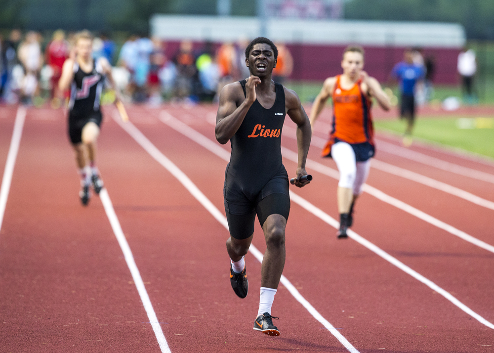 Lanphier's Dontarius Anderson, center, runs the final leg of the 4x200m Relay to victory with a time of 1:30.34 during the Boys Central State Eight Track & Field Meet at Glenwood High School, Friday, May 15, 2015, in Chatham, Ill. Justin L. Fowler/The State Journal-Register