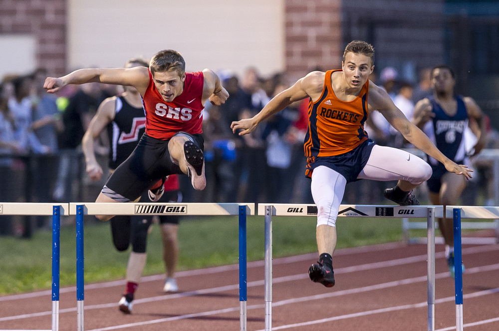 Springfield's Tanner Coleclasure, center, battles with Rochester's Aaron Cable, right, before winning the Boys 300m Hurdles during the Boys Central State Eight Track & Field Meet at Glenwood High School, Friday, May 15, 2015, in Chatham, Ill. Justin L. Fowler/The State Journal-Register