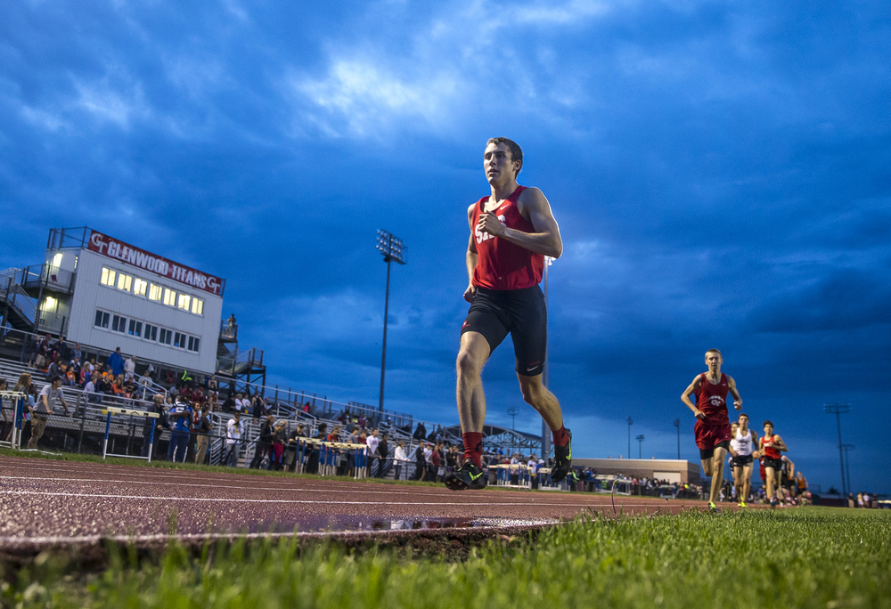 Springfield's Heath Warren opens up a lead on the second lap of the Boys 1600m Run during the Boys Central State Eight Track & Field Meet at Glenwood High School, Friday, May 15, 2015, in Chatham, Ill. Justin L. Fowler/The State Journal-Register
