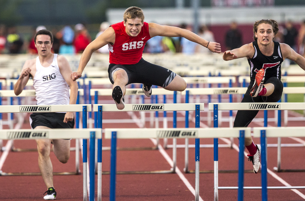 Springfield's Tanner Coleclasure, center, takes home the victory in the Boys 110m Hurdles during the Boys Central State Eight Track & Field Meet at Glenwood High School, Friday, May 15, 2015, in Chatham, Ill. Justin L. Fowler/The State Journal-Register