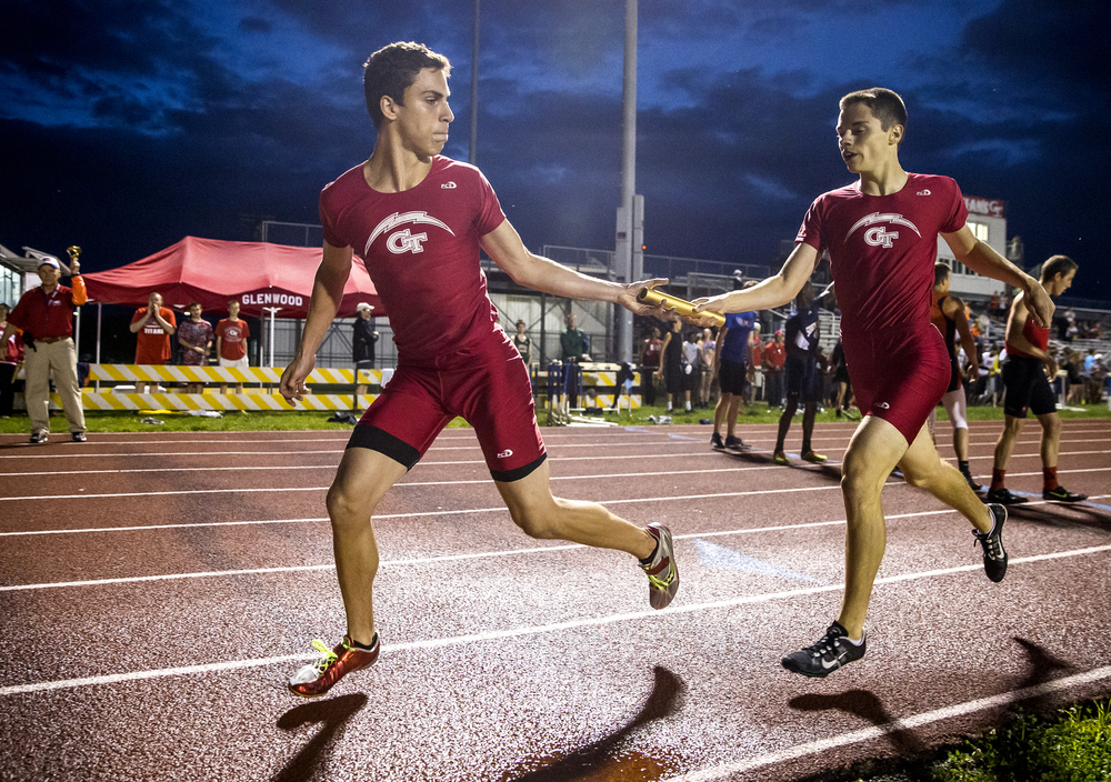 Glenwood's Dominic Giovannelli takes the baton from Ryan Walters, right, to run the final leg of the Boys 4x400m Relay during the Boys Central State Eight Track & Field Meet at Glenwood High School, Friday, May 15, 2015, in Chatham, Ill. Glenwood won the event with a time of 3:25.28. Justin L. Fowler/The State Journal-Register