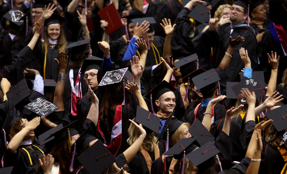 After receiving their degrees and before turning their tassels to the left, new Benedictine graduates acknowledge family and friends attending the Commencement by waving and blowing air kisses. David Spencer/The State Journal-Register