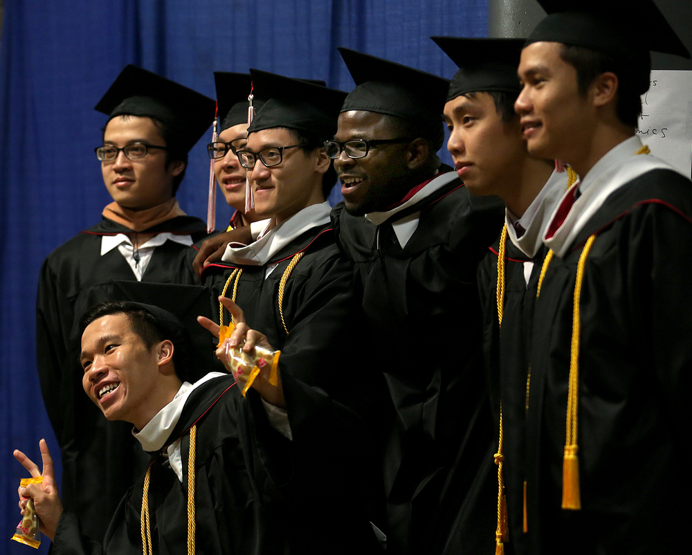 Graduate Chien Doan of Vietnam at front gets his picture taken along with his fellow graduates (other than Demetrius Bonner) earning their Bachelor of Arts in International Business & Economics before the start of the procession.  David Spencer/The State Journal-Register