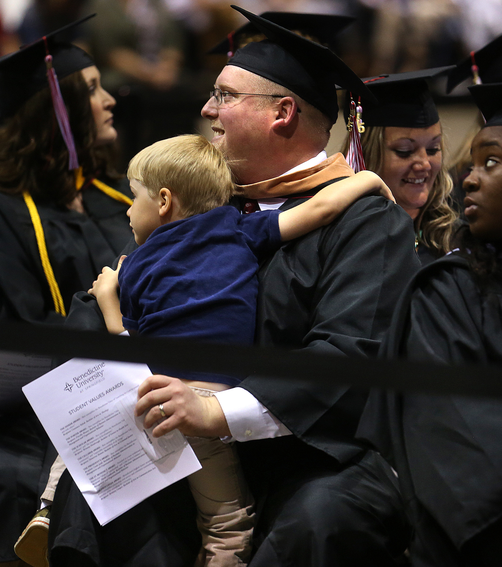 Graduate Eric Danner of Springfield got a surprise hug by a visitor shortly after processing: his son Jacob Danner, 3. David Spencer/The State Journal-Register